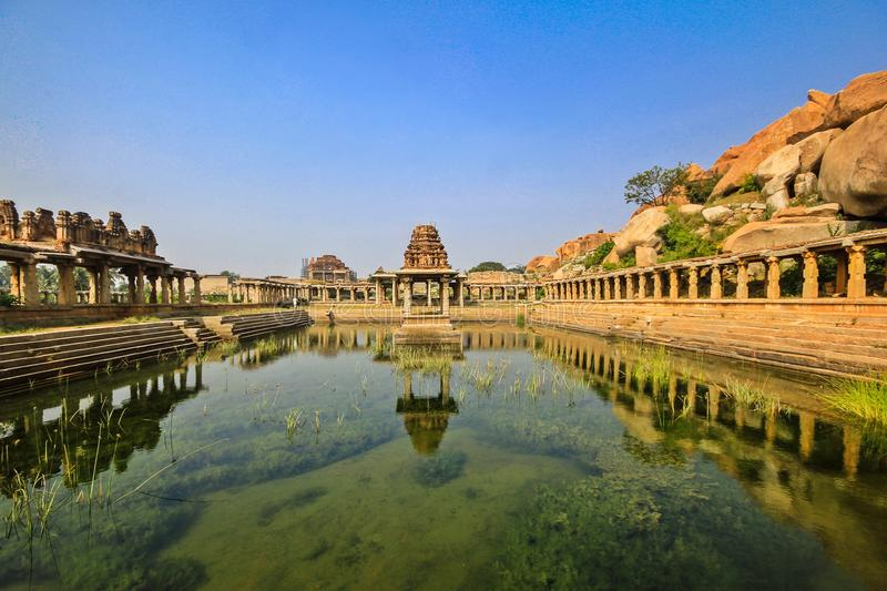 Historic Hampi sacred tank in India royalty free stock images