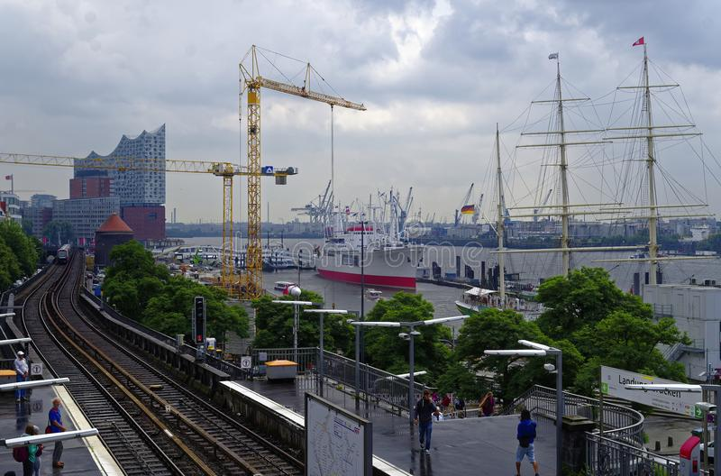 Historic harbor in Hamburg with ships and docks in the background and harbor facility with belfry in Germany Europe on 11 July 201 royalty free stock photography