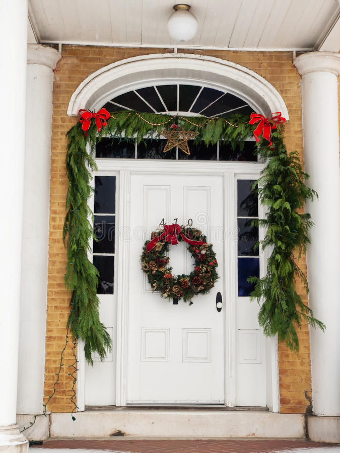 Historic home with Christmas decorations. Historic brick home with pillared porch and Christmas decorations and fresh snow in Jacksonville, Oregon royalty free stock photos