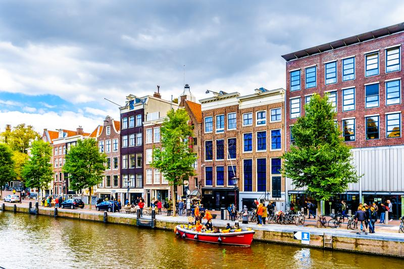 Historic Houses along the Prinsengracht canal in the Jordaan neighborhood with Anne Frank House the third building from the right. Amsterdam, the Netherlands royalty free stock photo