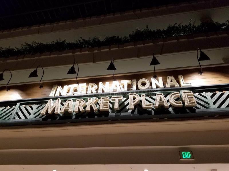 Historic International Market Place Sign. Waikiki - September 4, 2016: Historic International Market Place Sign on display at night. The sign was in the front of stock photos