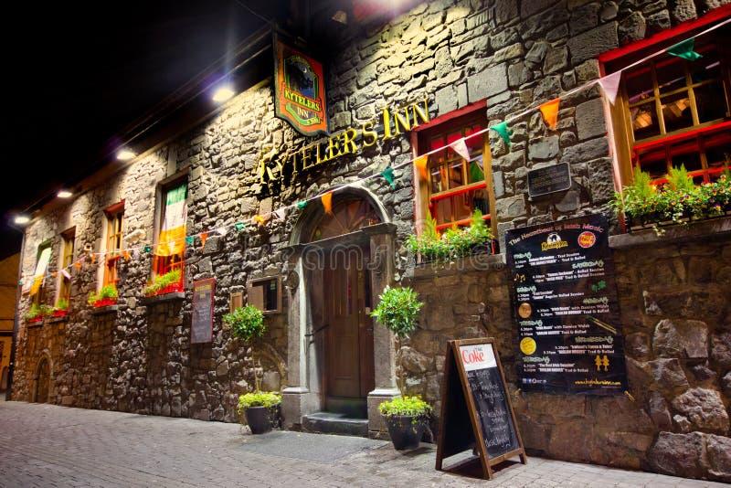Historic Irish Pub. KILKENNY, IRELAND - MAR 27: Historic Kytelers Inn in Kilkenny City, Ireland on the night of March 27, 2013. This landmark Medieval Irish pub