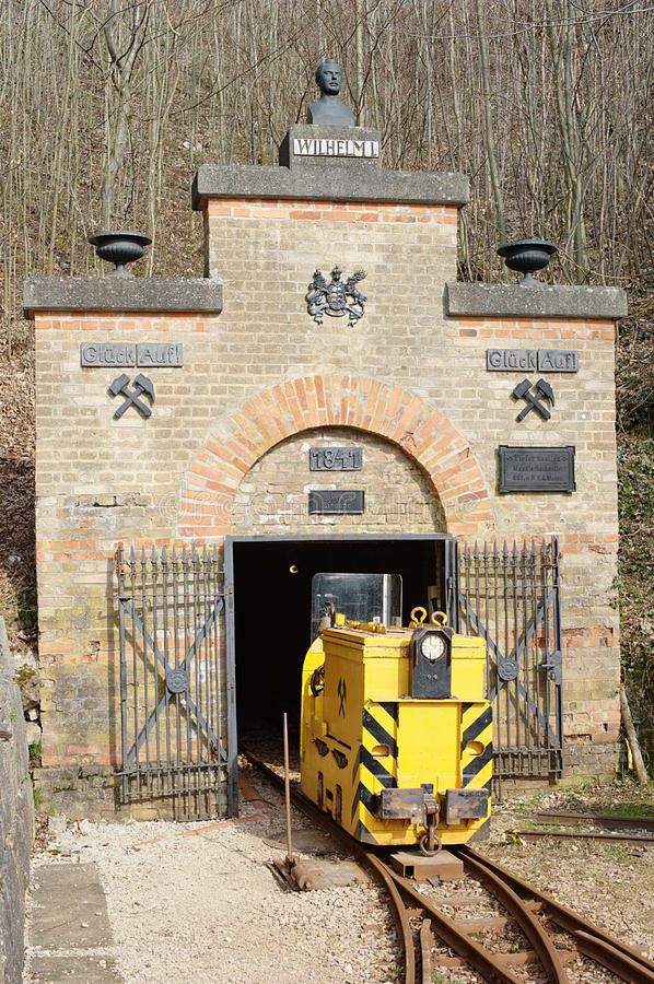 Historic Iron Ore Mine. Entrance gate of the Tiefer Stollen (deep gallery), near Aalen, South Germany. This iron ore mine was in use from 1840 to 1924. It was stock photos