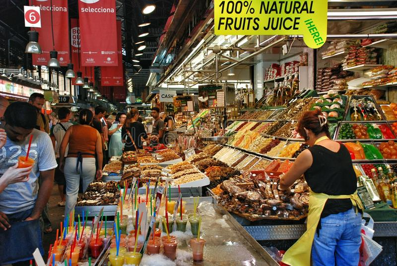 The historic La Boqueria market in Barcelona. The historic La Boqueria market with an impressive variety of gastronomic art occupies more than 2500 m2. Wrought royalty free stock photography