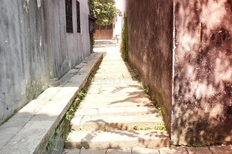A historic lane with mottled wall extending a mystery yard. A historic lane with mottled wall extending mystery yard stock photos