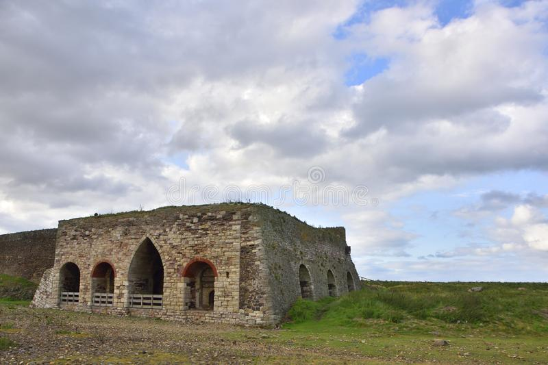Historic Lime Kilns on Island of North East England royalty free stock image