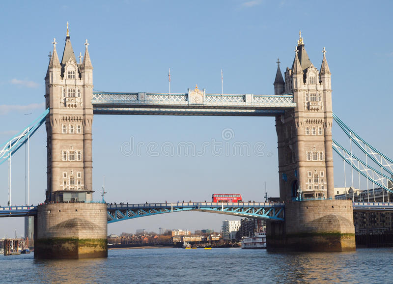 Tower Bridge London, England. Historic London Tower Bridge on the River Thames with a red London bus going over it. A popular tourist attration and London icon royalty free stock images