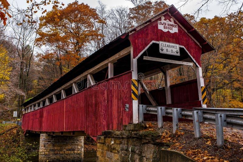 Historic Lower Humbert Covered Bridge - Autumn Splendor - Somerset County, Pennsylvania. An autumn view of the historic Lower Humbert Kingpost truss covered stock images