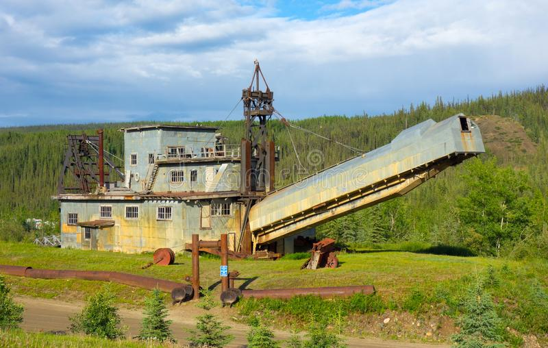 An ancient dredge on display at a gold-mining operation in alaska. An historic machine used for extracting placer gold during the klondike days at chicken royalty free stock photo