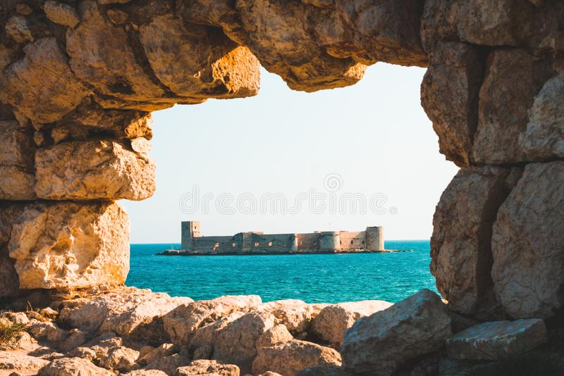 Historic maiden`s castle. On the sea stock photography