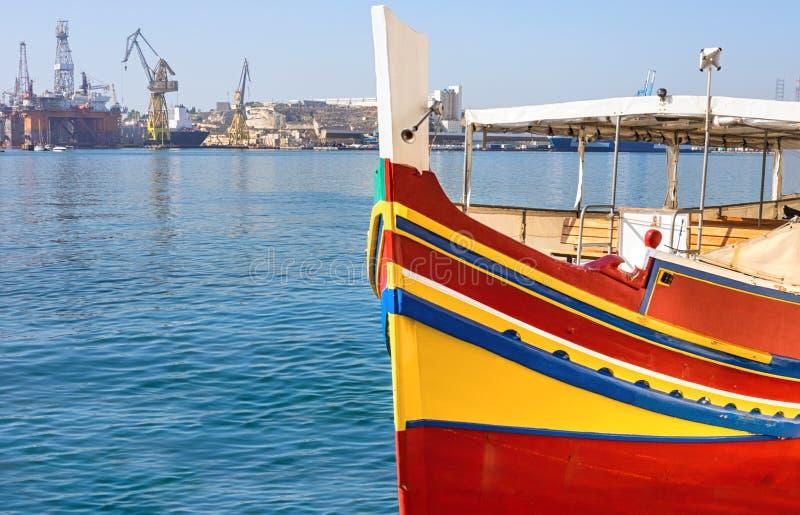 Historic Maltese boat in Grand Valetta Bay in Malta stock photo