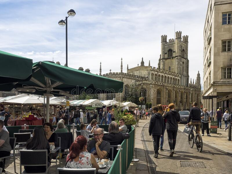 The Historic Market in Market Square overlooked by Great St Mary's Church. CAMBRIDGE, UNITED KINGDOM - Aug 11, 2017: CAMBRIDGE, UK:  The Historic Market in stock photo