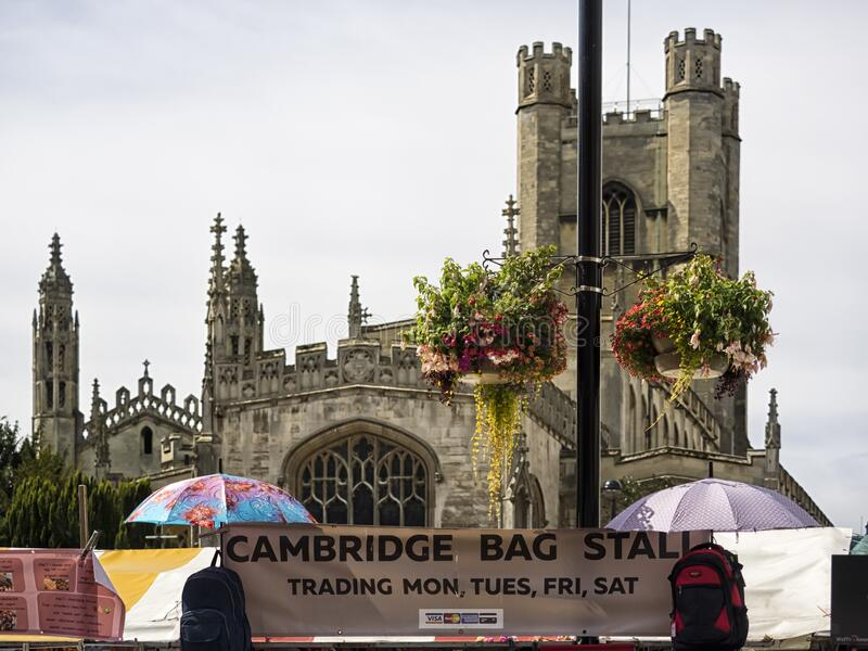 The Historic Market in Market Square overlooked by Great St Mary's Church. CAMBRIDGE, UNITED KINGDOM - Aug 11, 2017: CAMBRIDGE, UK:  The Historic Market in stock images