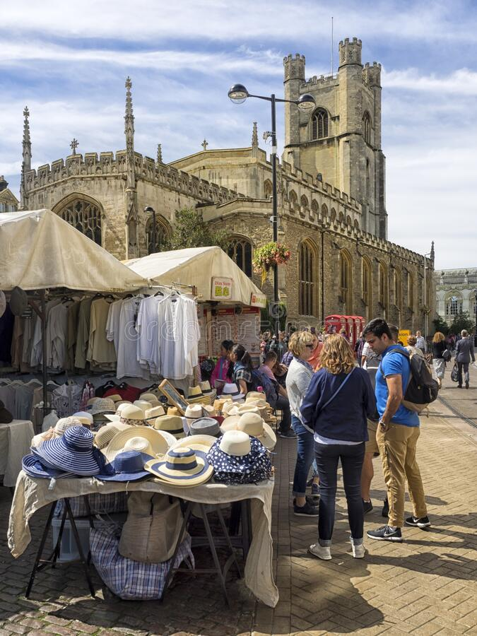 The Historic Market in Market Square overlooked by Great St Mary's Church. CAMBRIDGE, UNITED KINGDOM - Aug 11, 2017: CAMBRIDGE, UK:  The Historic Market in royalty free stock images