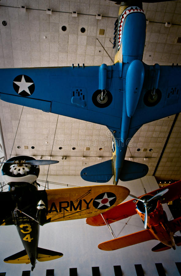 Historic military aircraft hanging in a museum
