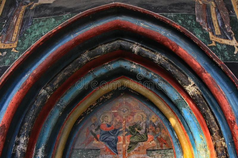 Historic monastery entrance detail. Beautiful painted shapes from an old historical monastery located in Bucovina Romania royalty free stock images
