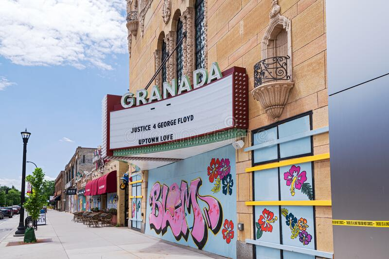 Historic movie palace and storefronts in uptown stock photo