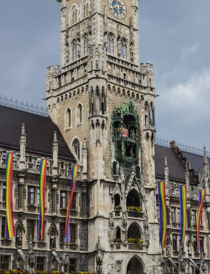 The historic Munich town hall at the Marienplatz decorated with rainbow flags for the Christopher Street Day CSD event, Germany.  royalty free stock photos