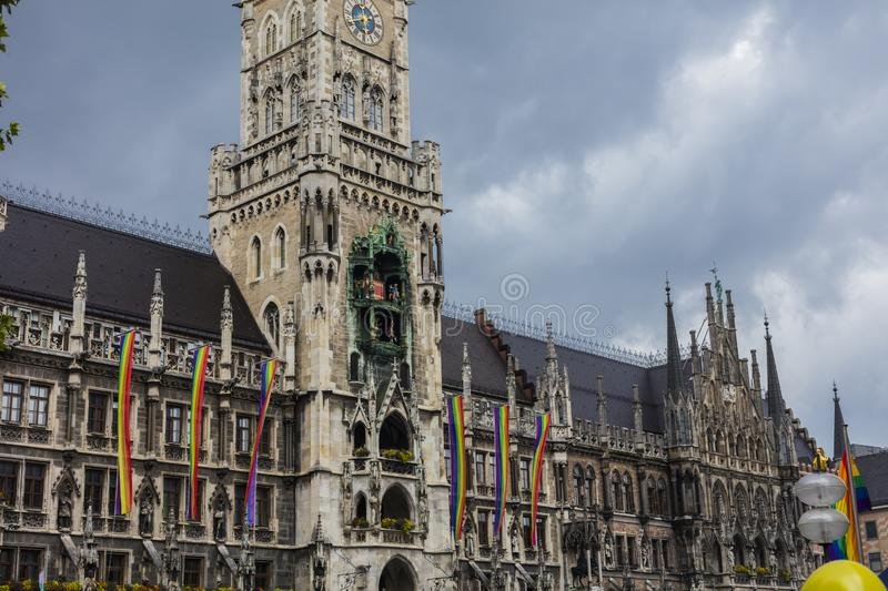 The historic Munich town hall at the Marienplatz decorated with rainbow flags for the Christopher Street Day CSD event, Germany.  royalty free stock photography