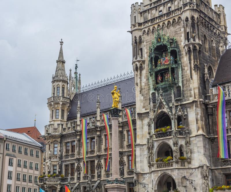 The historic Munich town hall at the Marienplatz decorated with rainbow flags for the Christopher Street Day CSD event, Germany.  stock photography