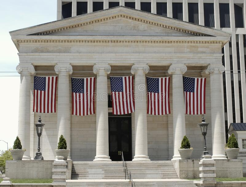 Historic Old Court House with Hanging Flags. Old Montgomery County Courthouse in Dayton, Ohio was built in 1850 and is an excellent example of Greek Revival royalty free stock photography