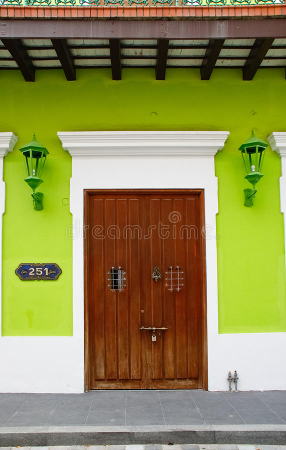 Historic Old San Juan - Green Walls Brown Door. A rich medium brown doors set against an electric green wall provide a beautiful view of Old San Juan Caribbean stock image