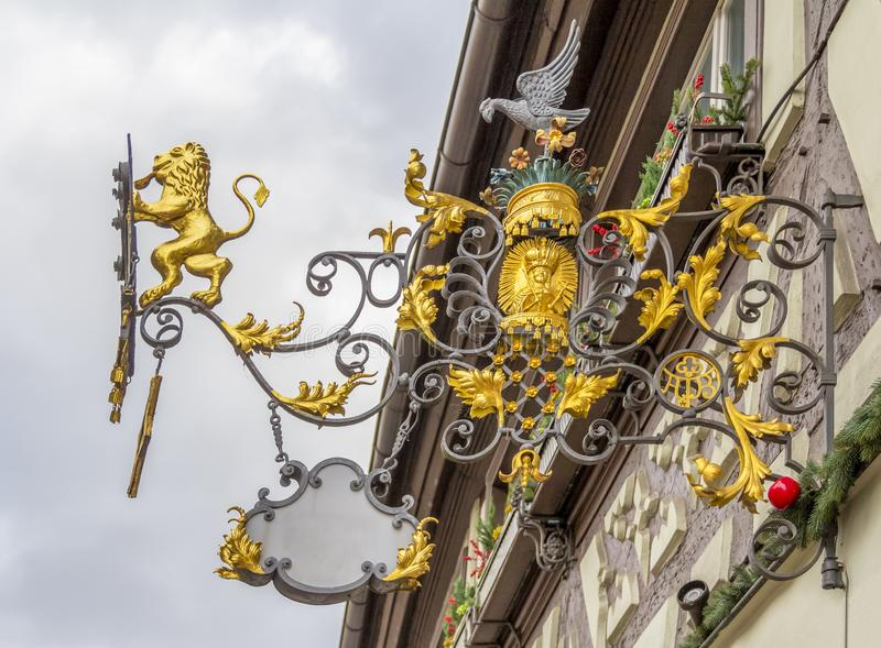 Historic ornamented sign. Low angle view of a historic ornamented sign royalty free stock image