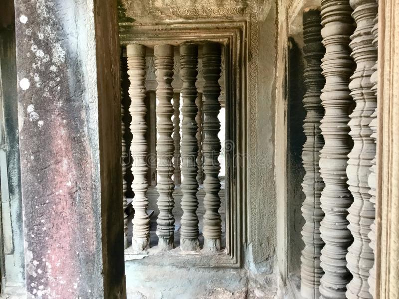 Historic pillars. Ancient architecture. Angkor Wat . Hindu Temple . Siem Reap. Cambodia. Angkor Wat is a temple complex in Cambodia and the largest religious stock photography