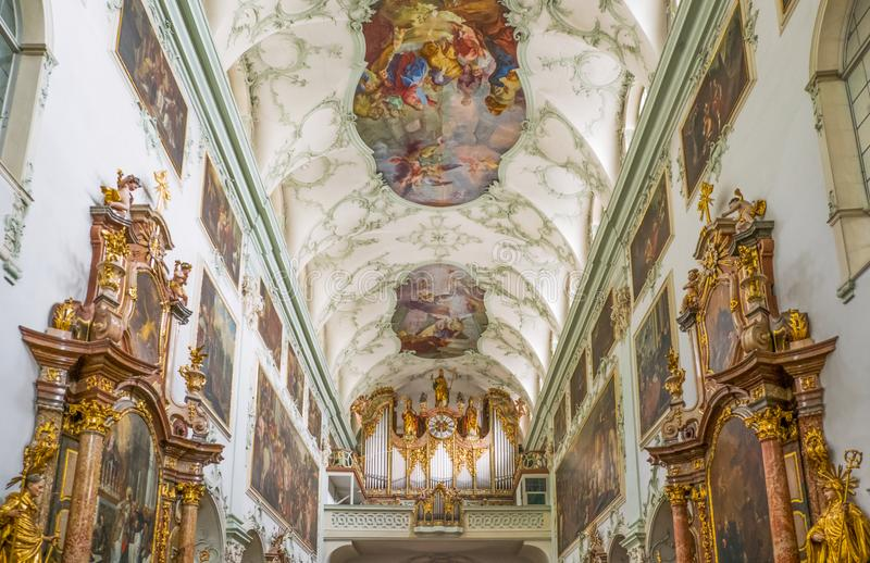 The historic places of Salzburg. Salzburg, Austria - August 4, 2016: The ancient organ in the nave of the St Peter Abbey Church royalty free stock images