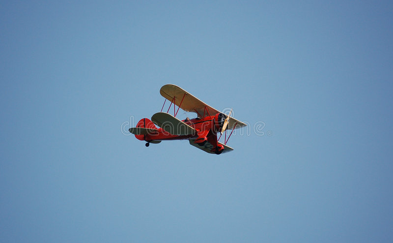 Historic Plane. Historic biplane in flight over Maine coast stock images