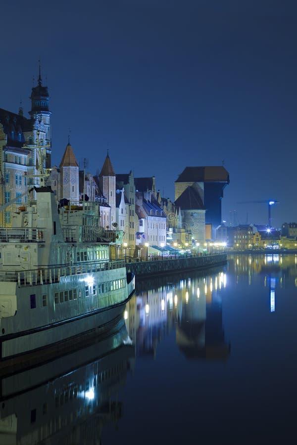 Historic Polish city of Gdansk at night royalty free stock photography