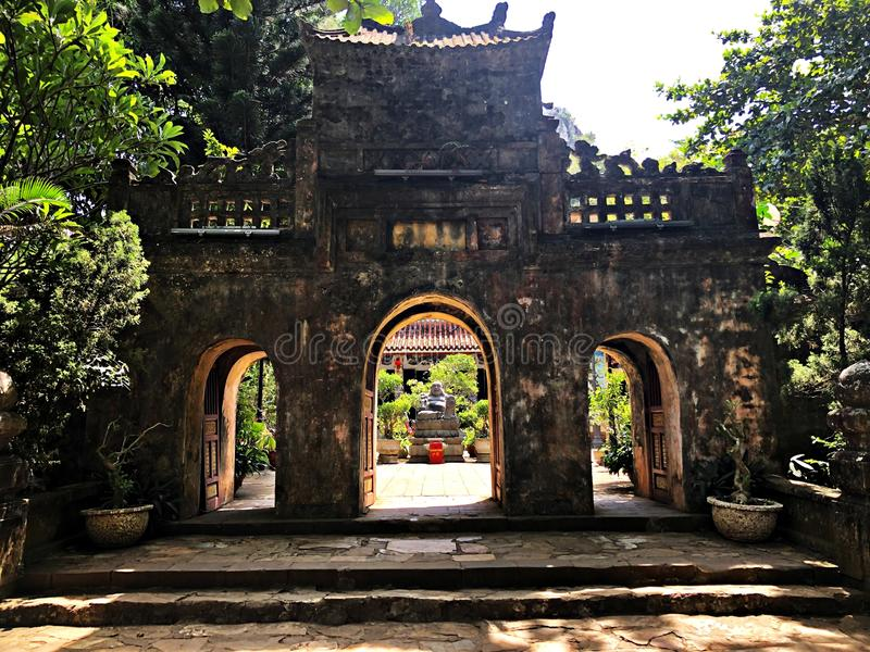 Ancient stones portal in Marble Mountain, Hoi An, Vietnam. Historic portal made of ancient stones, in Marble Mountain, Hoi An, Vietnam royalty free stock photography
