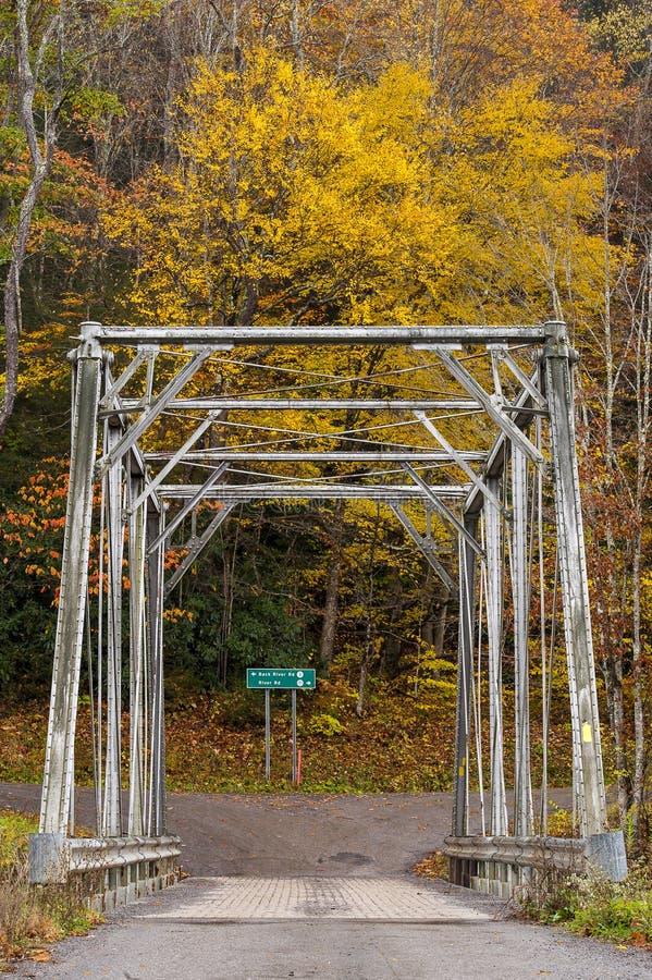 Historic Pratt Truss Bridge - East Fork Greenbrier River, West Virginia. An autumn view of a historic one-lane Pratt through truss bridge over the East Fork royalty free stock image