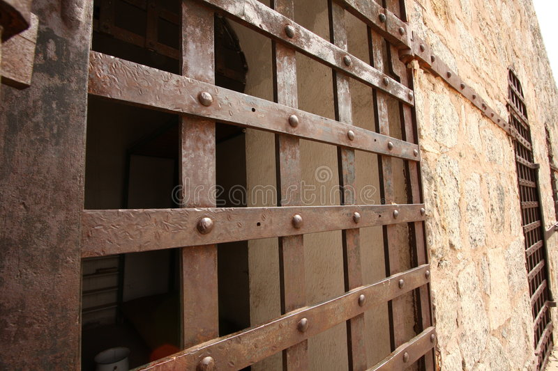 Historic prison cell door royalty free stock photo