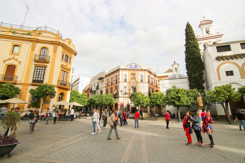 Historic quarter. Tourists take the pause in historic quarter at Sevilla, Andalusia, Spain royalty free stock photos