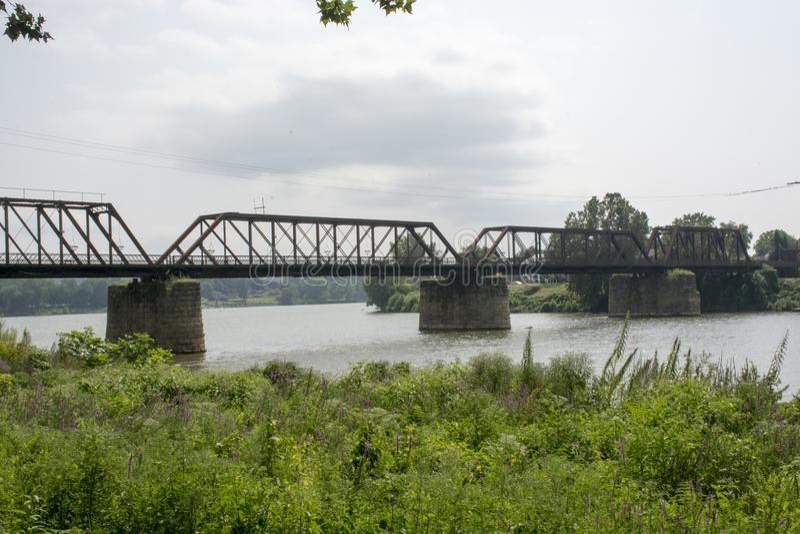Historic railroad bridge Marietta Ohio. A very old and historic railroad bridge across the Muskingham River at Marietta Ohio, built on the original supports for royalty free stock images