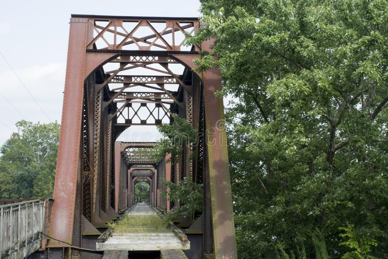 Historic railroad bridge Marietta Ohio. A very old and historic railroad bridge across the Muskingham River at Marietta Ohio, built on the original supports for stock photography