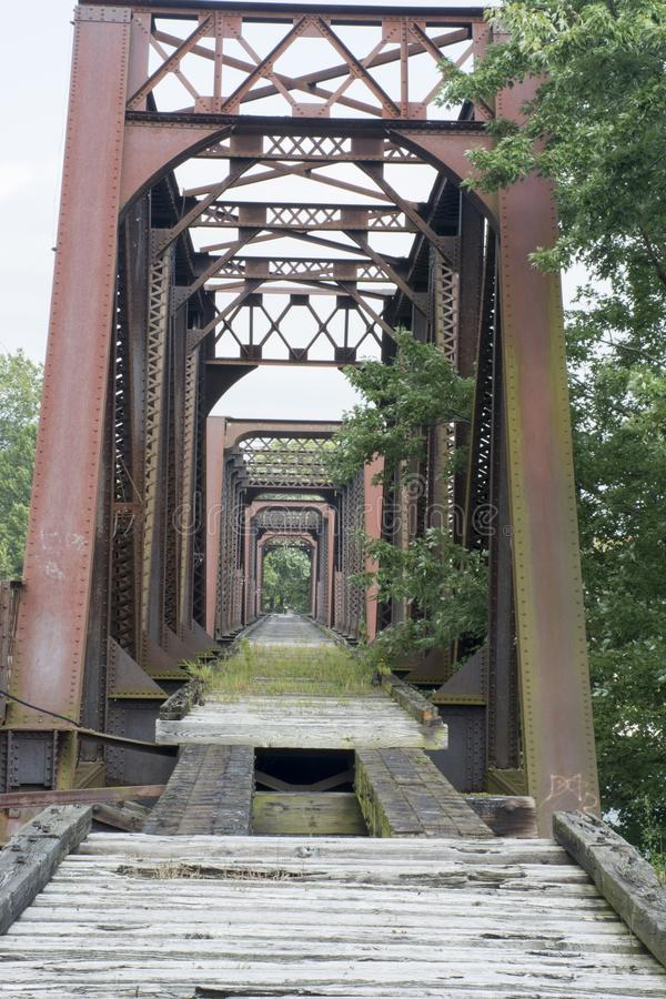 Historic railroad bridge Marietta Ohio. A very old and historic railroad bridge across the Muskingham River at Marietta Ohio, built on the original supports for stock image