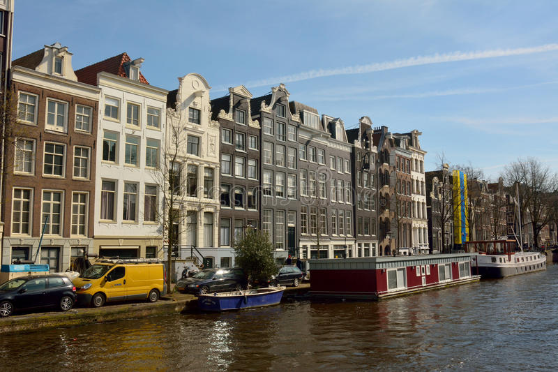 Historic residential buildings along Prinsengracht canal in Amsterdam. Amsterdam, The Netherlands – April 1, 2016. Historic residential buildings along stock images