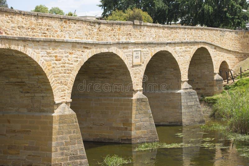 Historic Richmond Stone Bridge in Tasmania Australia. Heritage listed Stone Bridge in historic town of Richmond, Tasmania, oldest convict built construction of stock image