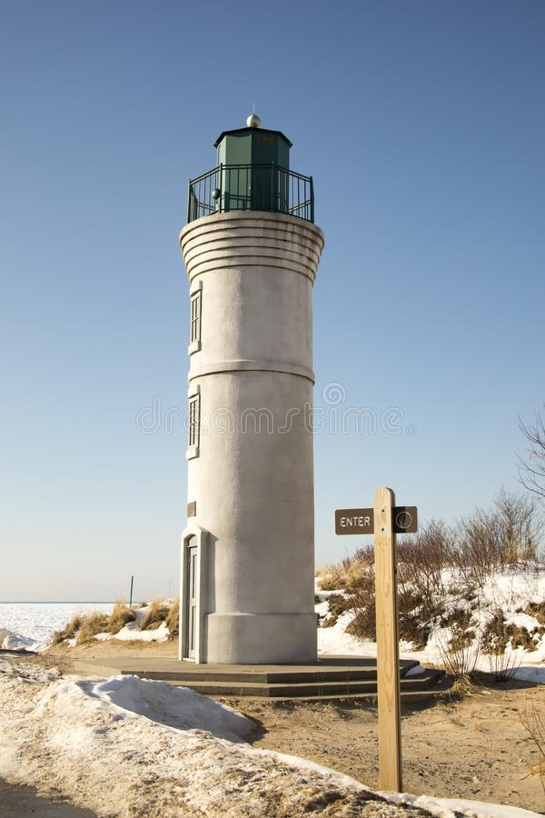 Historic Robert H Manning Lighthouse, Empire, Michigan in winter. Exterior of historic Robert H Manning Lighthouse on waterfront of frozen Lake Michigan in stock images
