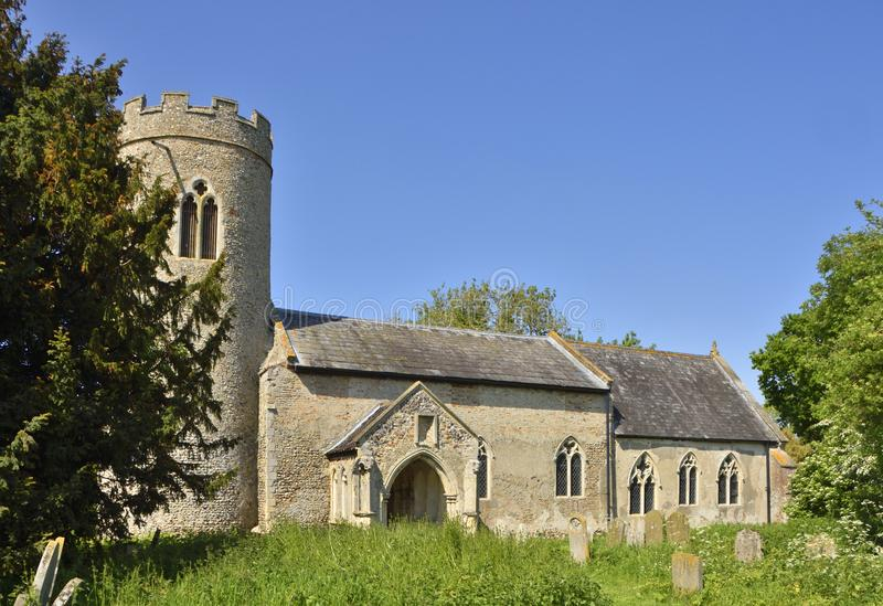 Historic Round Tower Church of East Anglia. View of the historic church of St. John the Baptist, Hellington in south Norfolk, England royalty free stock image