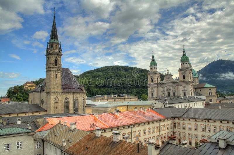 Historic Salzburg. Historic center of Salzburg, Franziskanerkirche to the left and Cathedral to the right stock image