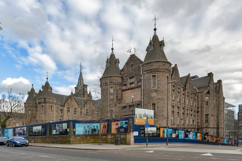 Historic Scottish Baronial style buildings of Old Surgical Hospital, now being restored for University of Edinburgh, Scotland, UK. Edinburgh, Scotland - April stock images