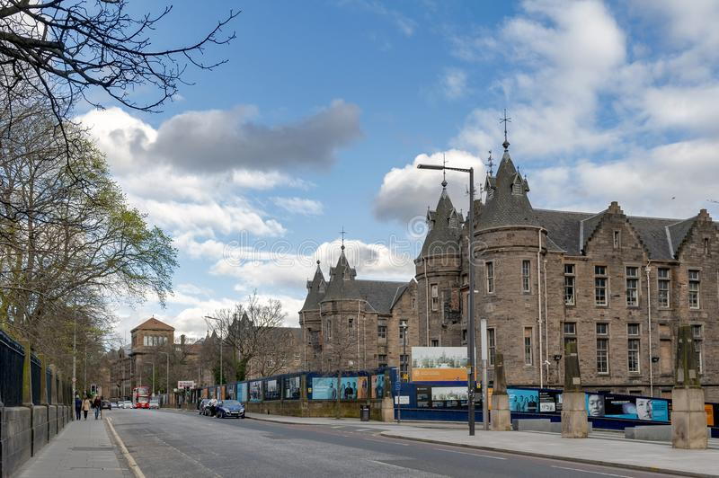 Historic Scottish Baronial style buildings of Old Surgical Hospital, now being restored for University of Edinburgh, Scotland, UK. Edinburgh, Scotland - April royalty free stock photography