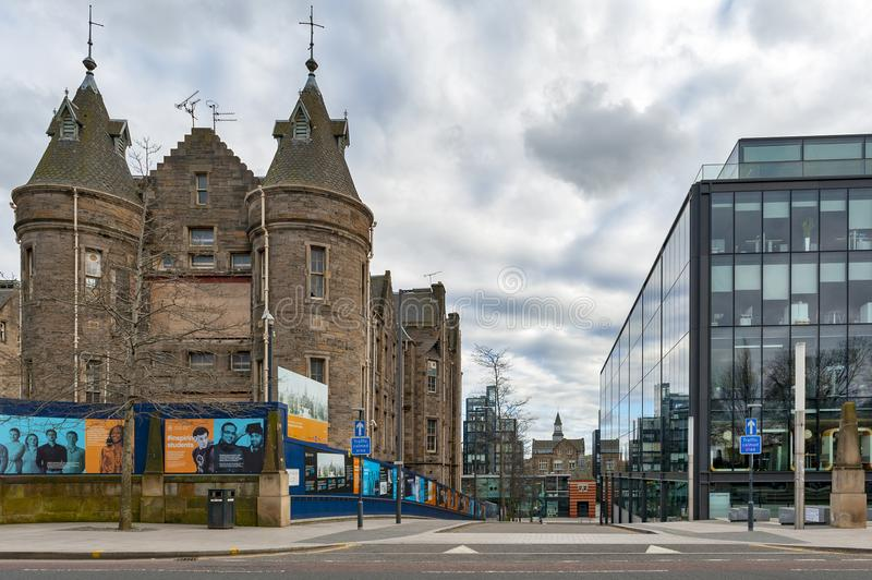 Historic Scottish Baronial style buildings of Old Surgical Hospital, now being restored for University of Edinburgh, Scotland, UK. Edinburgh, Scotland - April stock photography