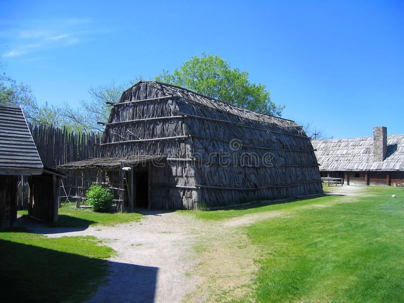 Traditional Huron Longhouse at Sainte Marie among the Hurons, Midland, Ontario, Canada. At the historic site of Sainte Marie among the Hurons Jesuit Mission royalty free stock photo