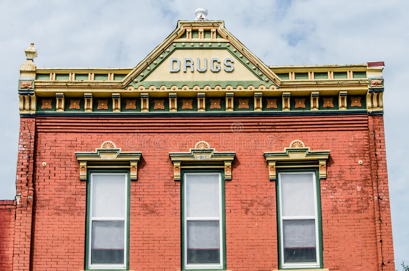 Historic small town architecture. Ornate historic old building / architecture of a Drug Store from early 1900's in Pleasant Hill, Missouri stock photography