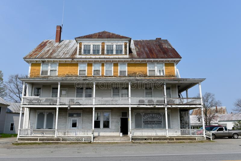 Historic Solon Hotel. This is a Spring picture of the deteriorating historic Solon Hotel located in Solon, Maine. This four story hotel opened on November 11 stock photography
