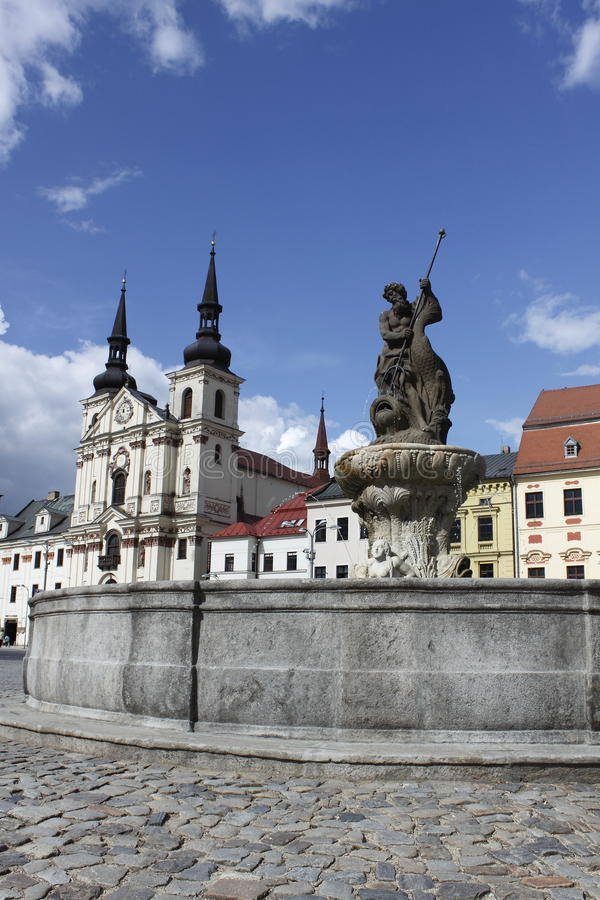 Historic square in Jihlava. (Czech Republic) dominated by the spires of baroque St. Ignatius church and the Neptun fountain stock photography